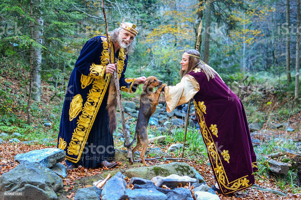 The old king, a queen and a small hunting dog stock photo