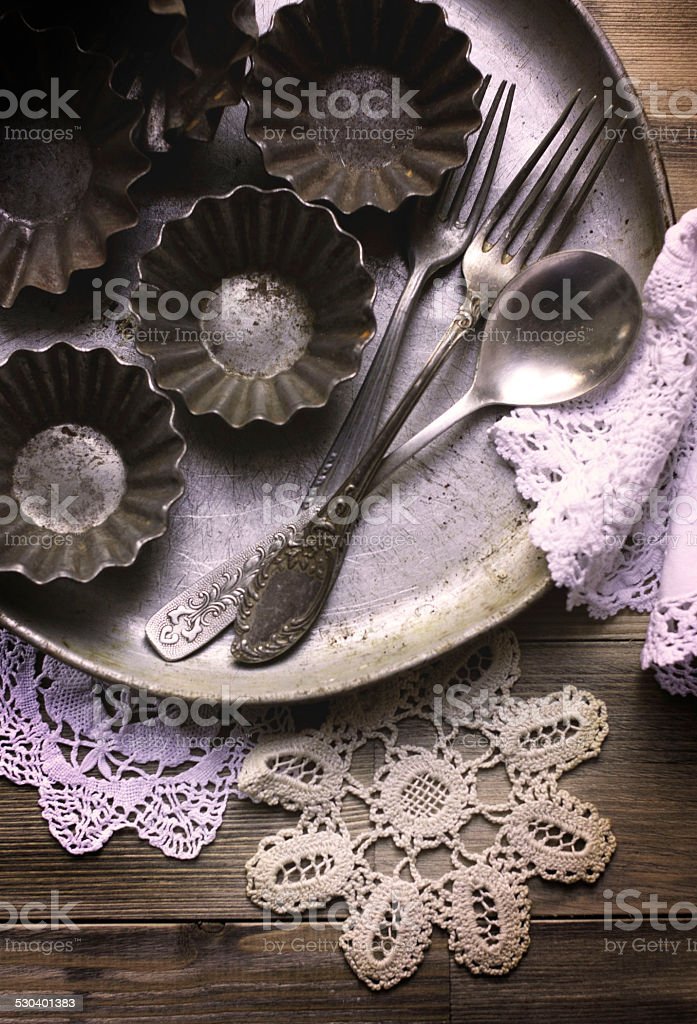 The old kitchen utensils and vintage lace napkins stock photo
