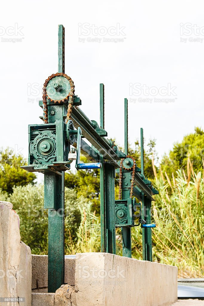 The old mechanism for shutoff of water in the channel stock photo