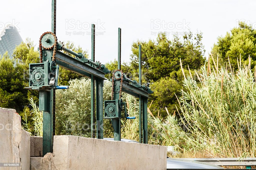 The old mechanism for shutoff of water in the channel, the chain stock photo
