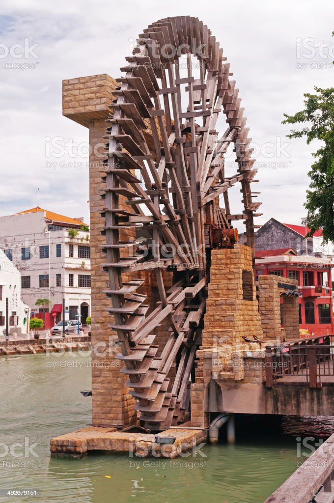The old port's water wheel in Malacca stock photo
