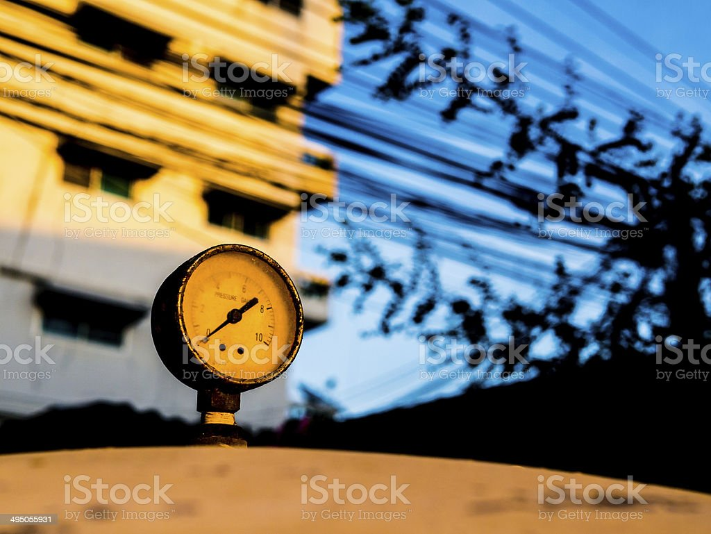 the old pressure gauge of watertank at sunset stock photo