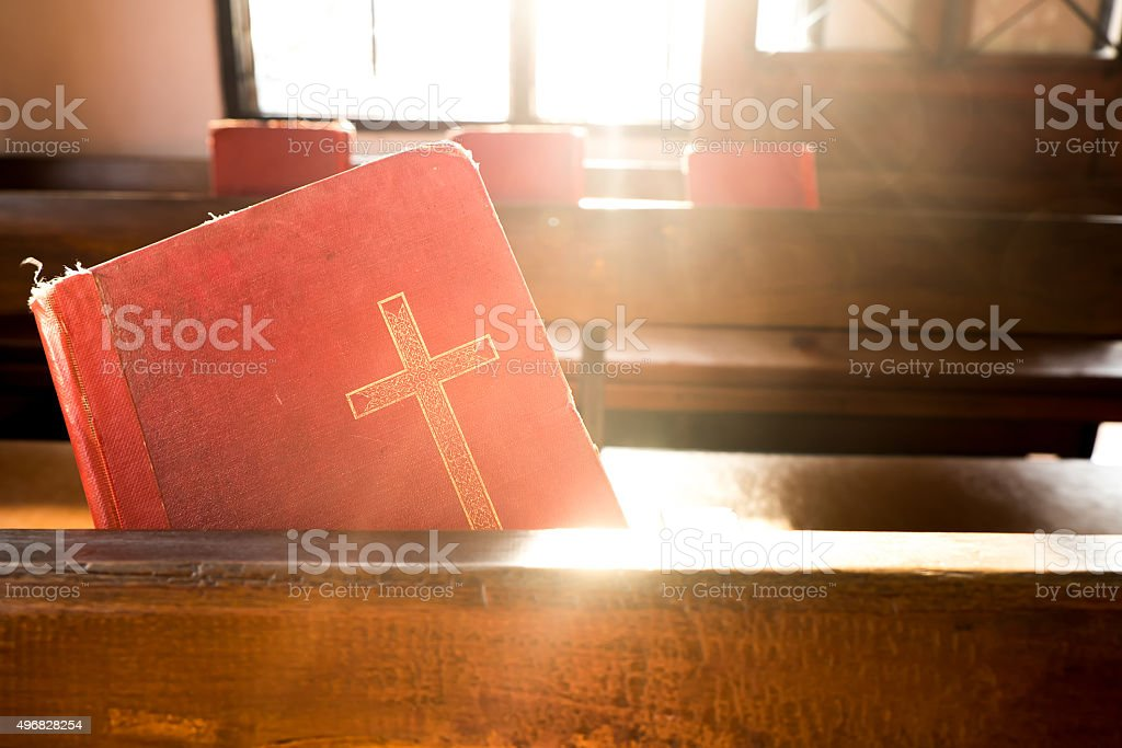 The old red books or red worship songbooks in church stock photo