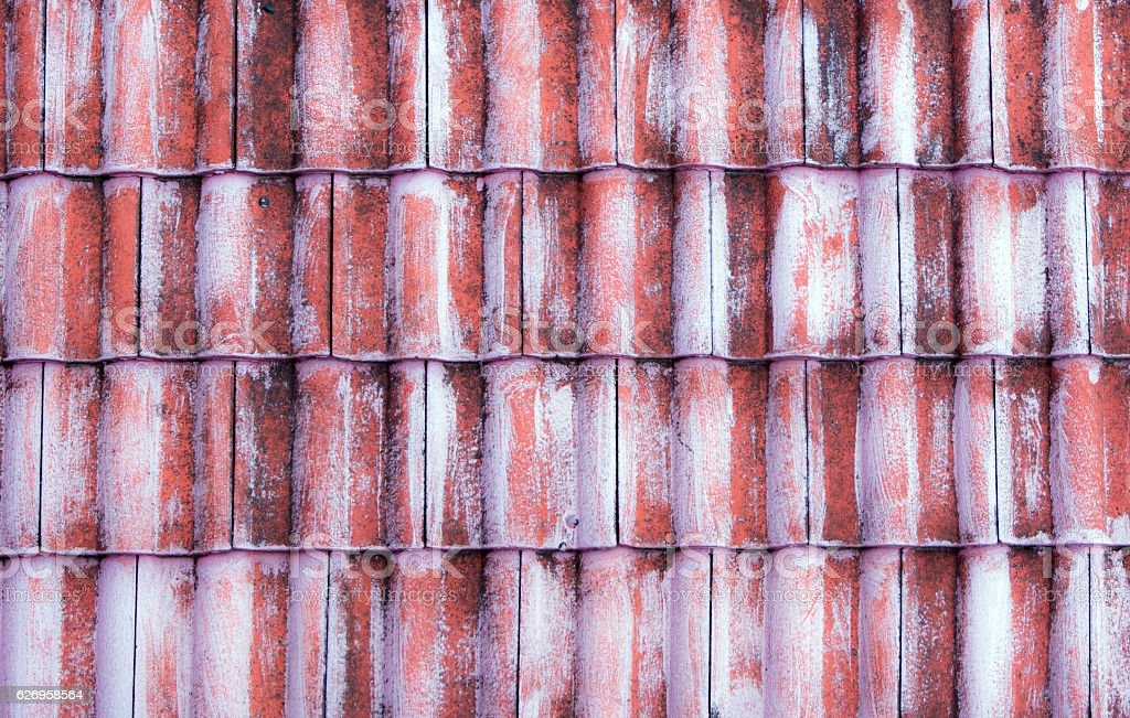 The old red tile on the roof stock photo