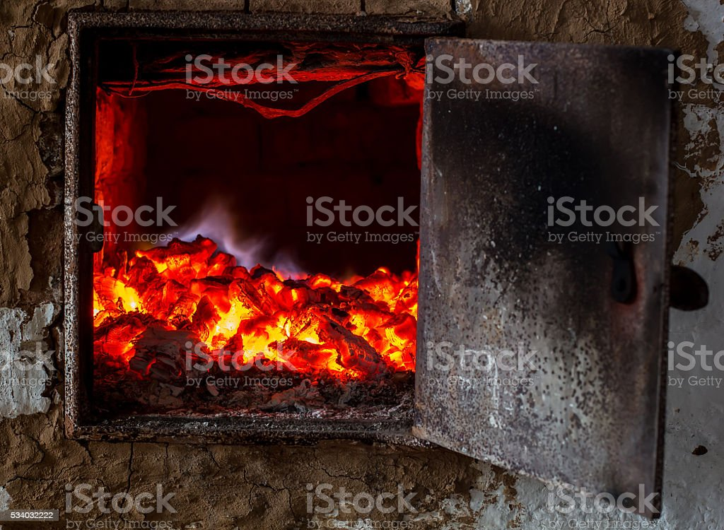 the old Russian oven smolder coals stock photo