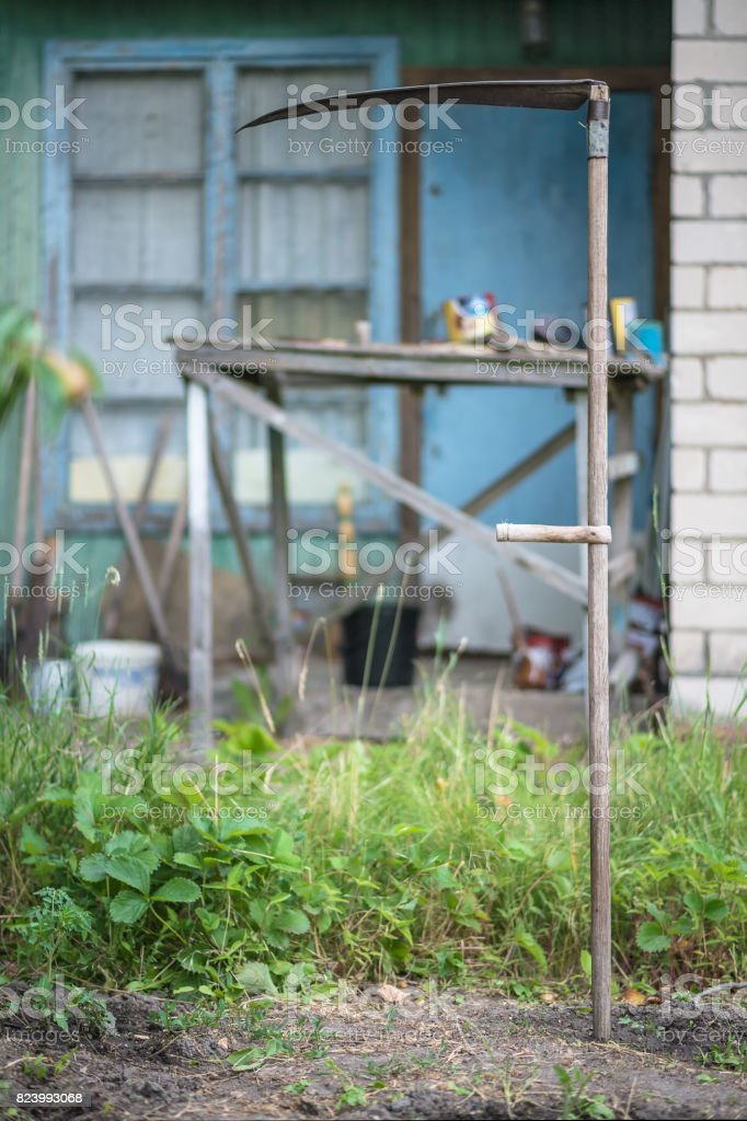 The old scythe, manual tool for cutting grass, Ukraine stock photo