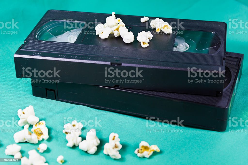 The old videotapes and popcorn stock photo