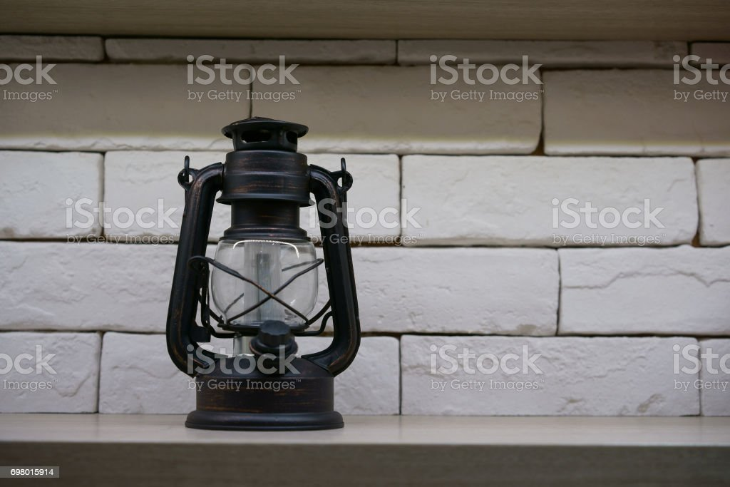 The old vintage metal lantern with fluorescense lamp inside stock photo