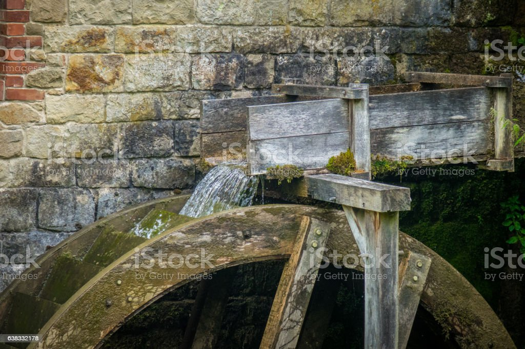 The old water mill on creek in village stock photo