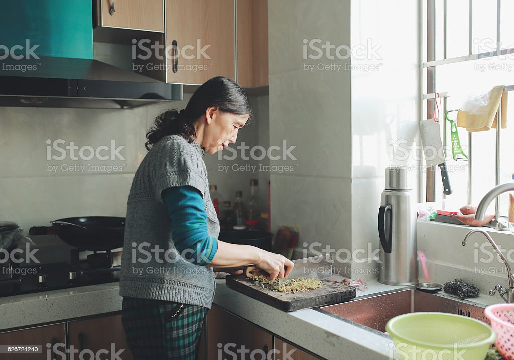 The old woman chopping stock photo