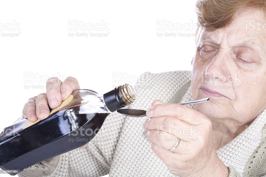 The old woman pours a liquid royalty-free stock photo