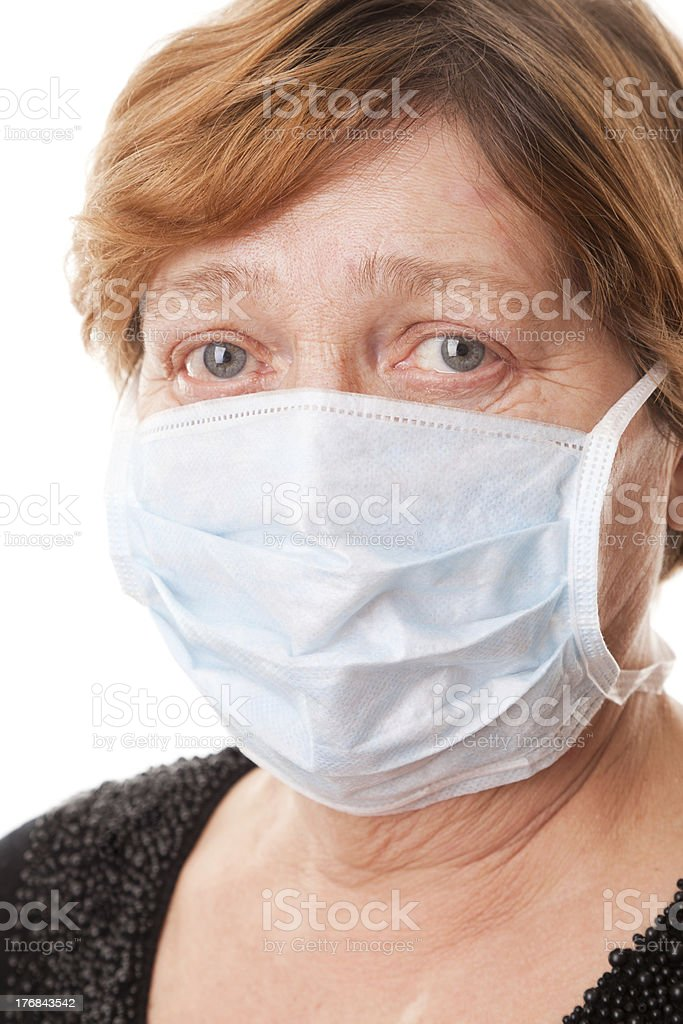 The old women in a Surgical Mask stock photo
