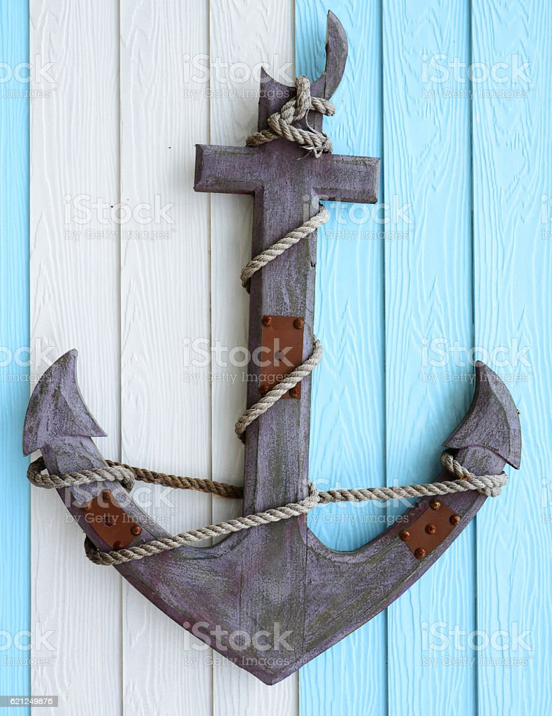 The Old wooden anchor on wood wall background stock photo