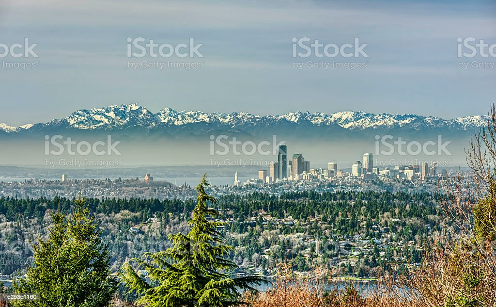 The Olympic Mountains cast their Shadow over Seattle stock photo