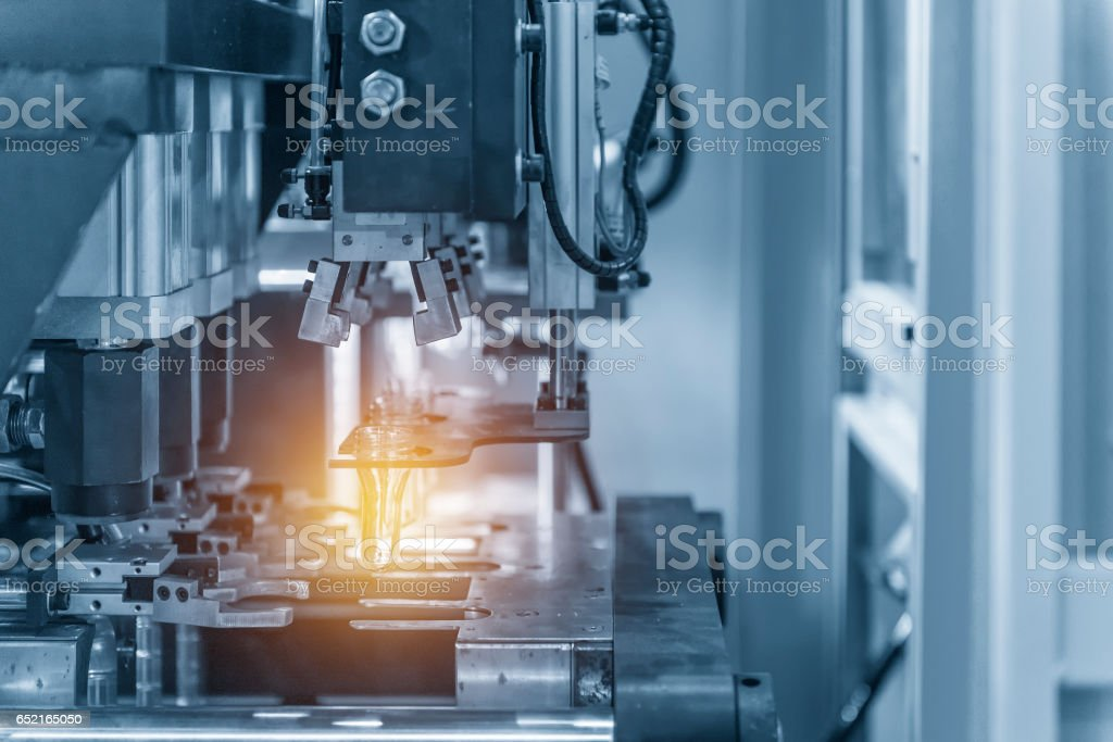 The operation of PET bottle blowing machine in light blue scene with lighting effect stock photo