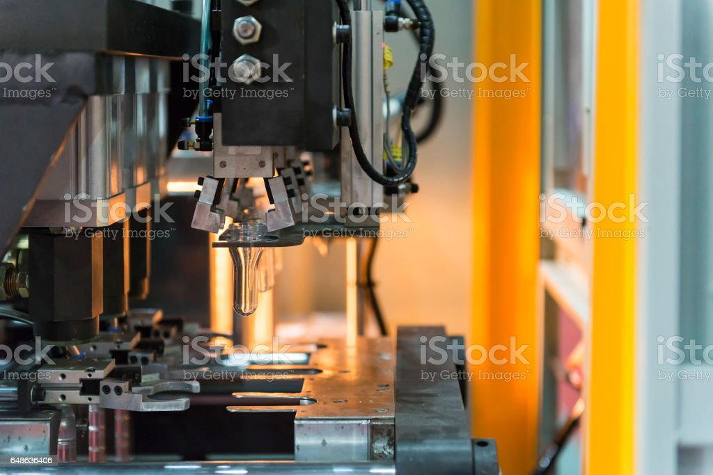 The operation of PET bottle blowing machine stock photo
