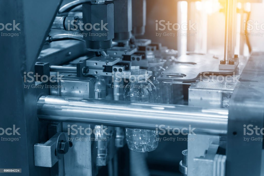 The operation of  plastic bottle  blowing machine stock photo