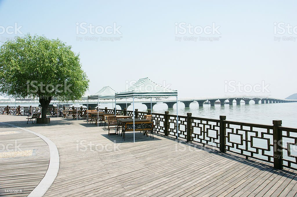 The outdoor lakeside wood terrace royalty-free stock photo