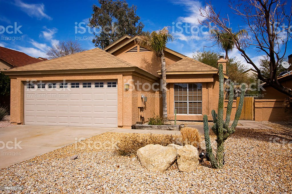 The outside of a modern home with a big garage stock photo