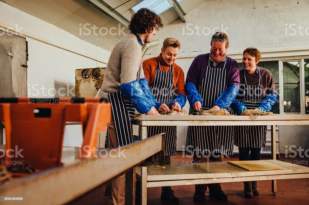 The Owner and Staff Preparing Food stock photo