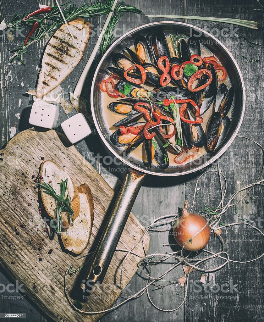 the oysters in the pan on wooden table stock photo