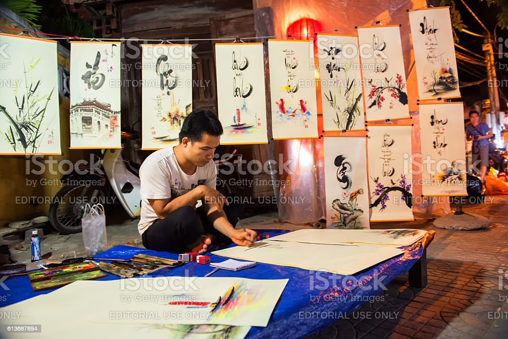 The painter man in Hoi An stock photo