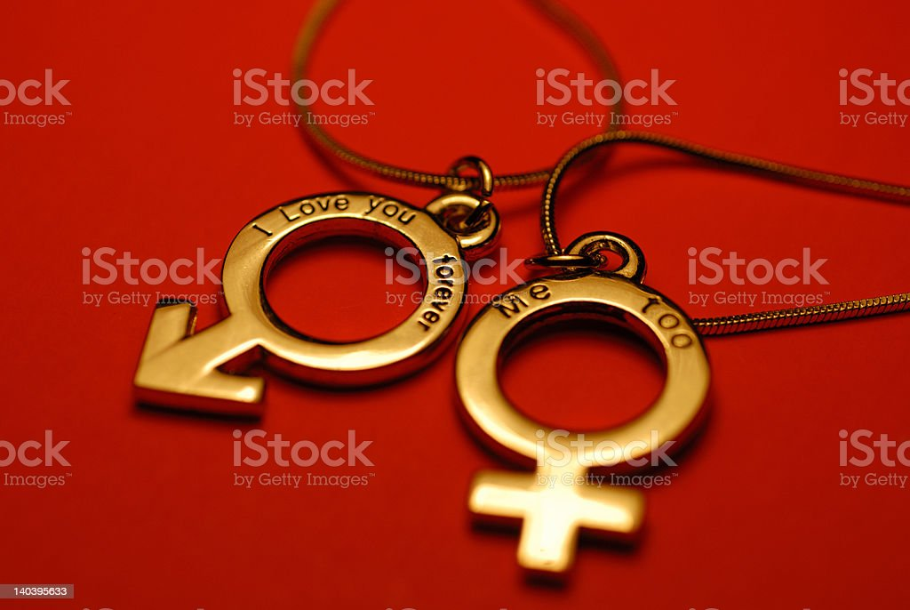 The pair of lovers' necklaces royalty-free stock photo