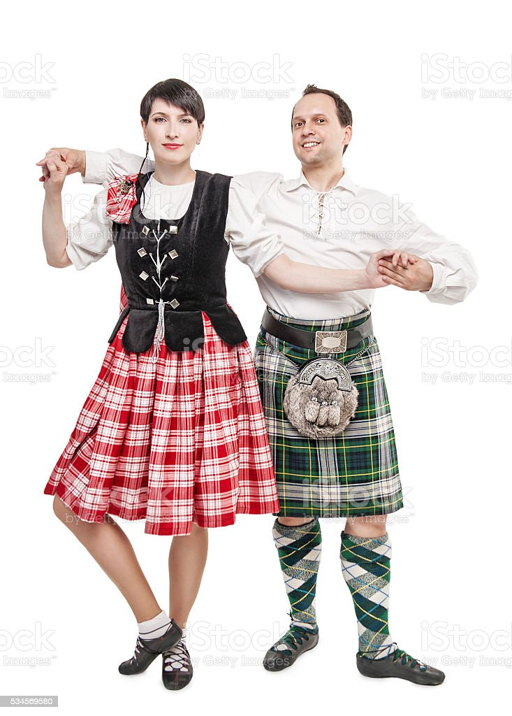 The pair woman and man dancing Scottish dance stock photo