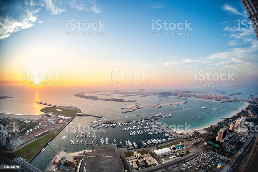 The palm Jumeirah in Dubai with skyline at sunset stock photo