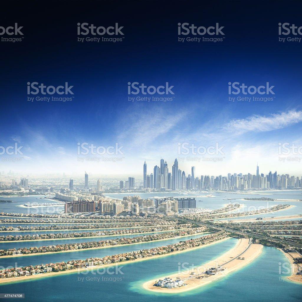 the palm jumeirah in Dubai with skyline stock photo