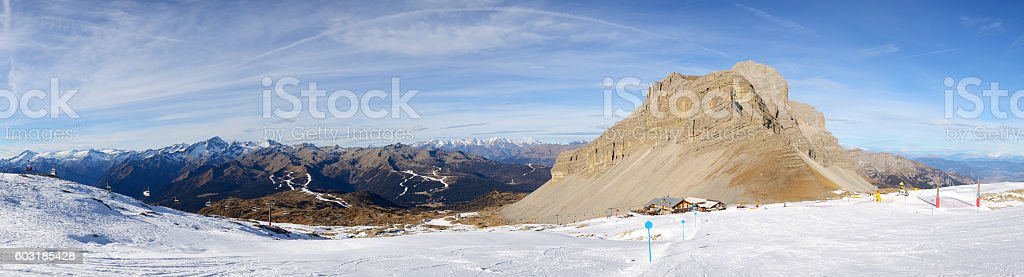 The panorama of ski slope and skiers at Passo Groste stock photo