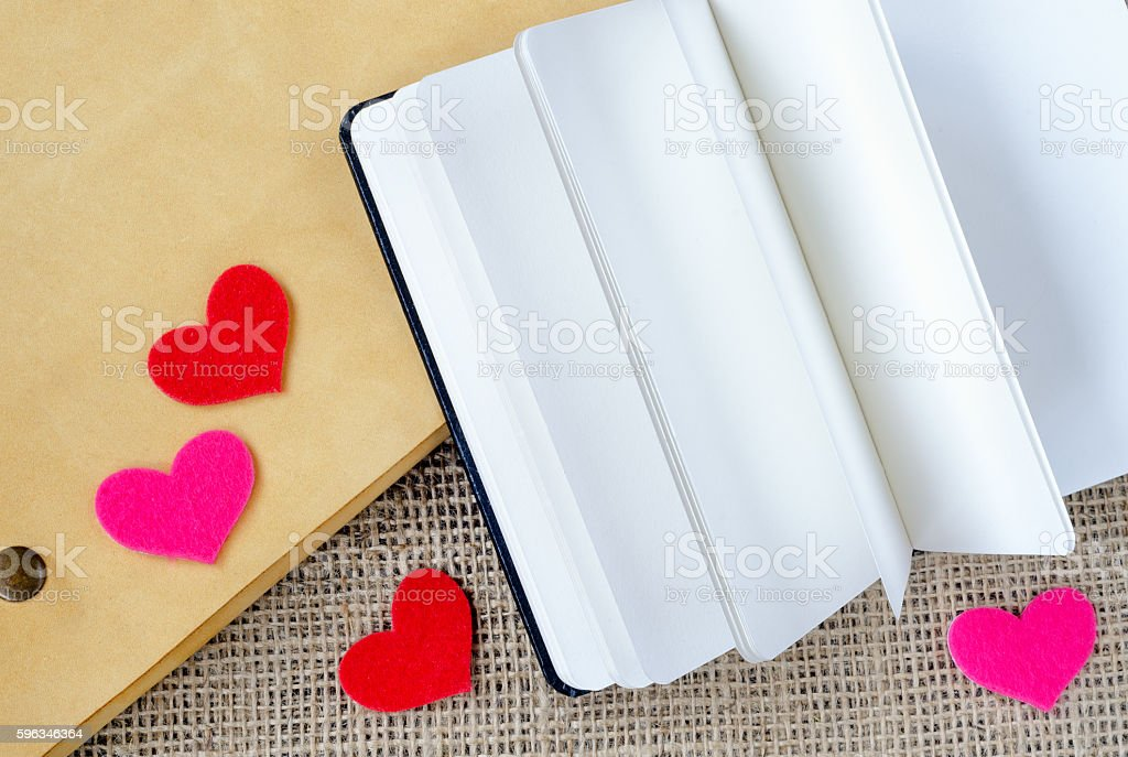 The paper hearts and notebook on the sackcloth stock photo