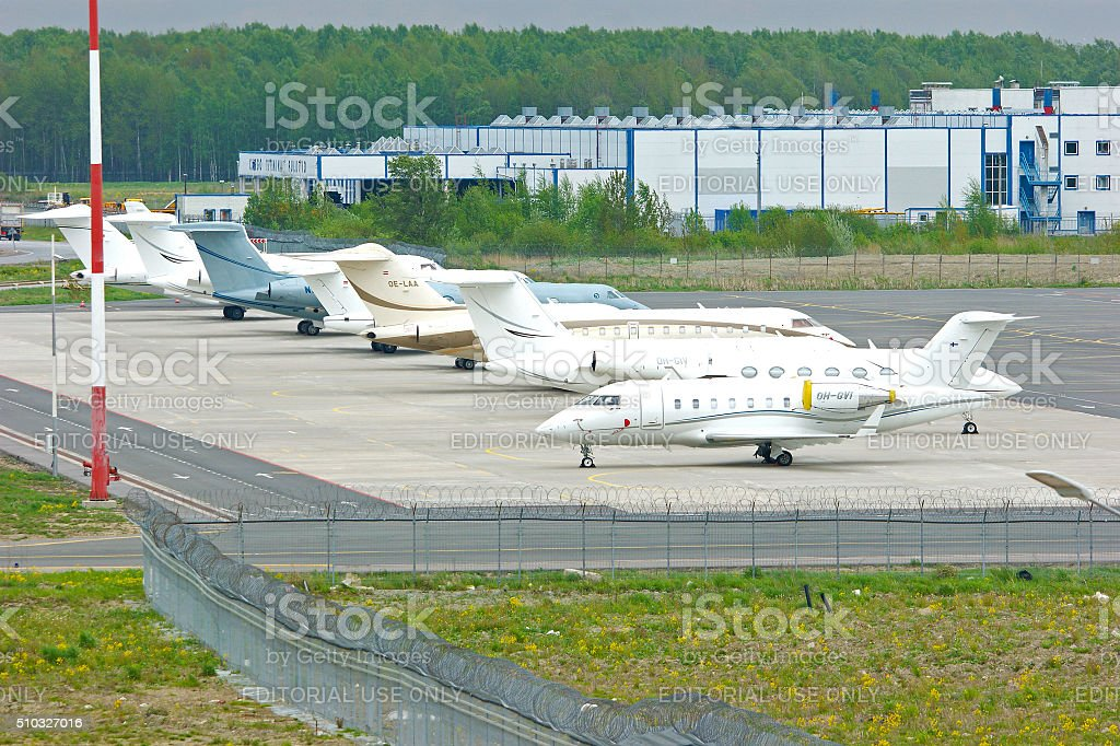 The parking of business jets in Pulkovo International airport stock photo