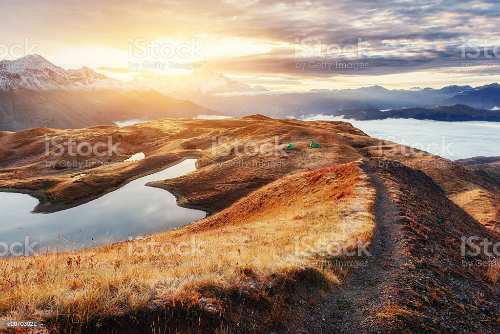 The path leading ridge pass Goulet at sunset. Upper Svaneti, stock photo