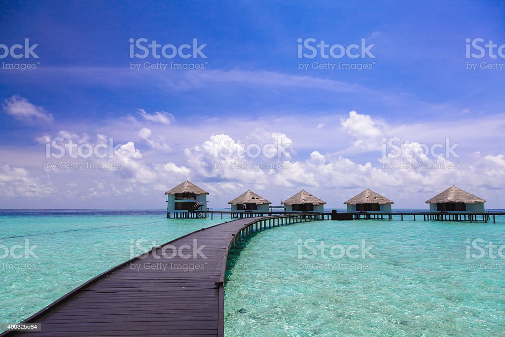 The path to the bungalow over the water stock photo
