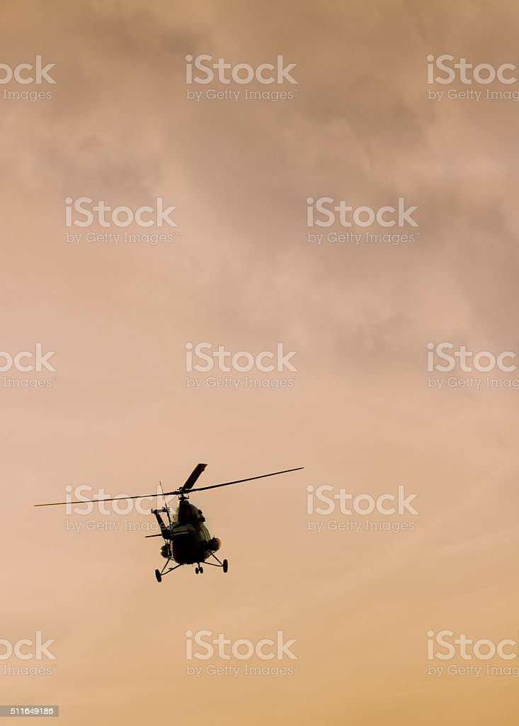 The patrol helicopter flying in the sky stock photo