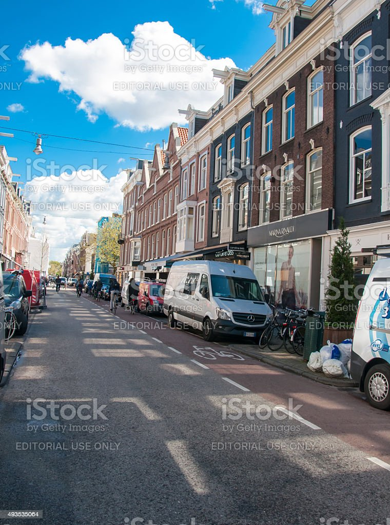The P.C.Hooftstraat fashion street with the row of shops. Amsterdam. stock photo