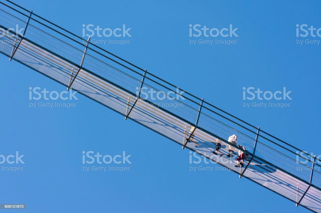 The pedestrian suspension bridge called Highline 179 in Reutte, longest 406 meters, in Austria stock photo