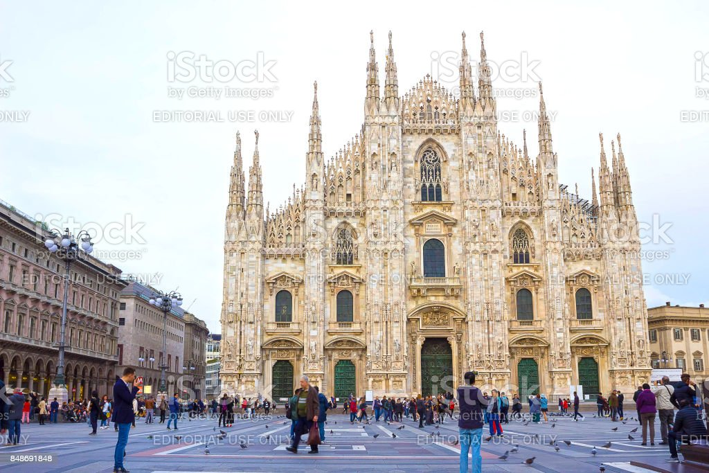 Milan, Italy - May 03, 2017: The people going at Duomo square in Milan. stock photo