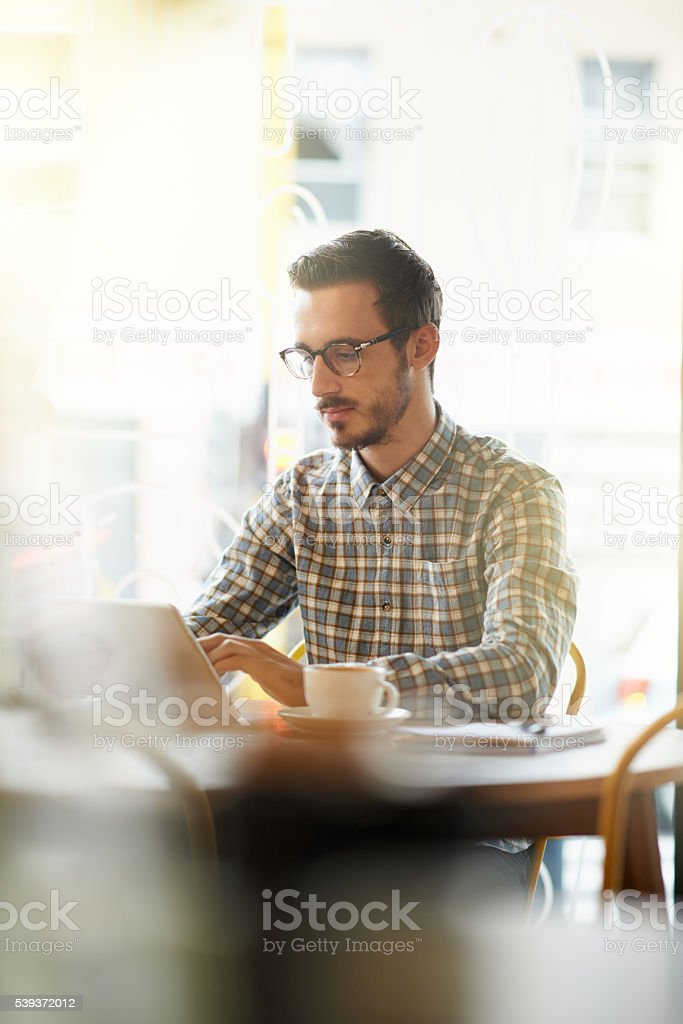 The perfect blend of caffeine and wifi stock photo