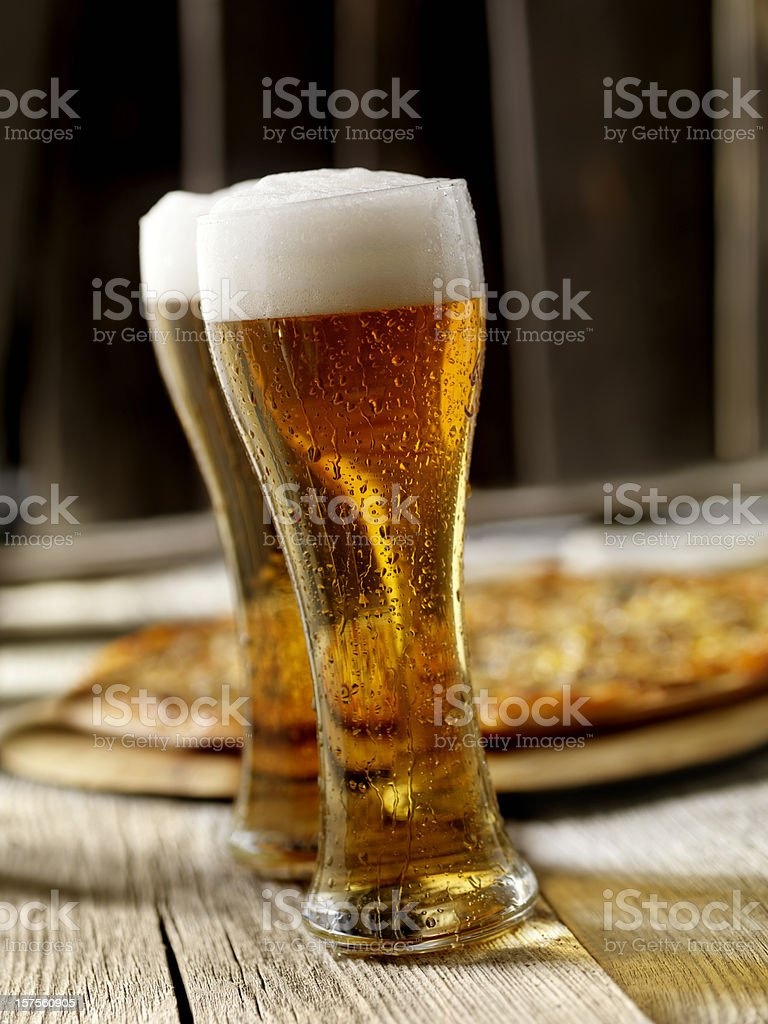 The Perfect Pint of Beer and Pizza royalty-free stock photo