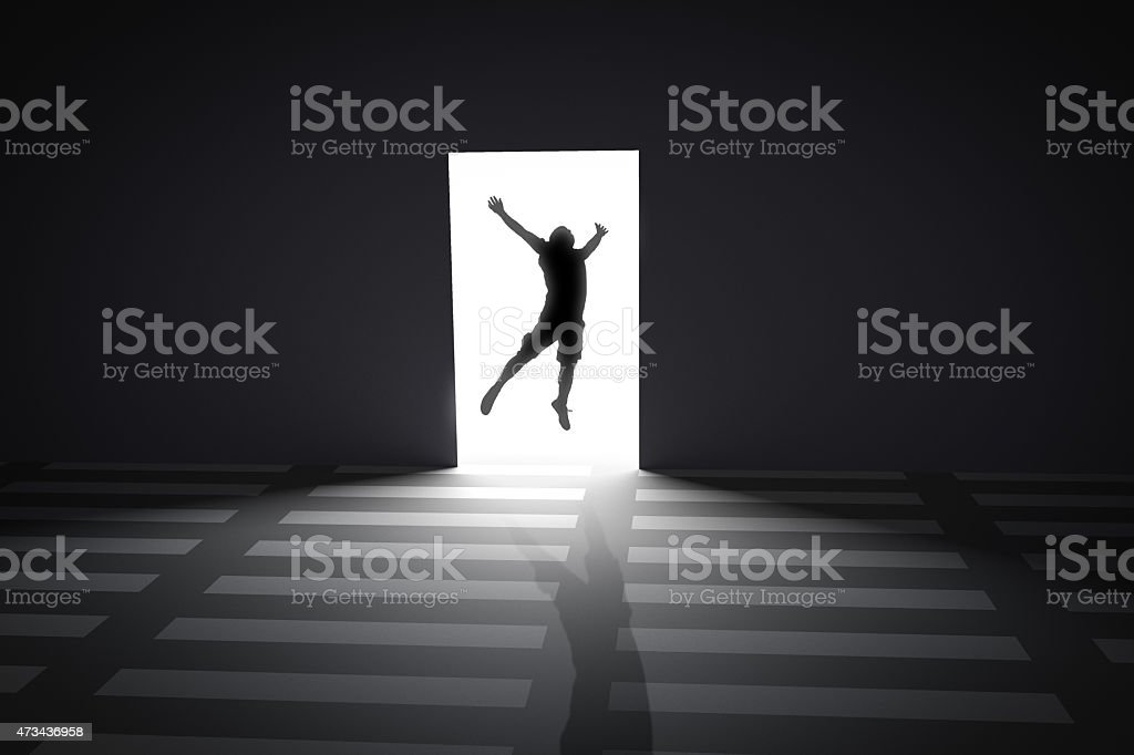 The person jumping at gate with light  opening concept stock photo