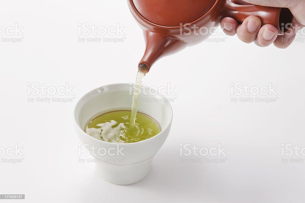 The person who serves tea royalty-free stock photo