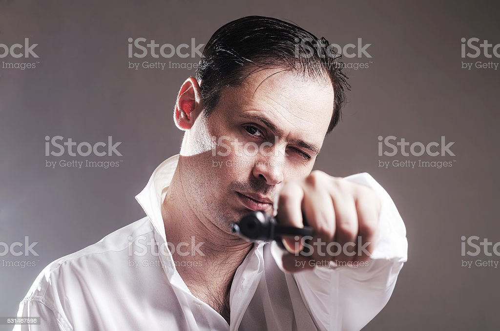 The person with the pistol stock photo