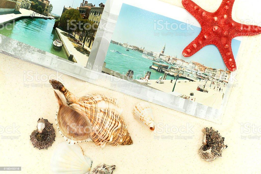 the photobook, cockleshells and starfish are on sand stock photo