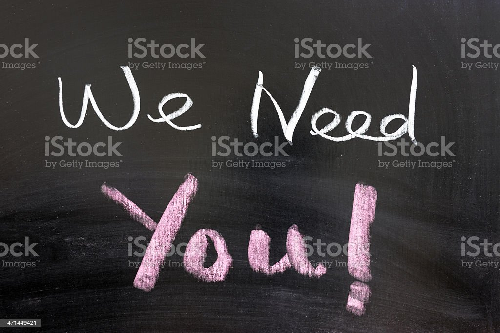The phrase 'We Need You ' written in chalk on a blackboard stock photo