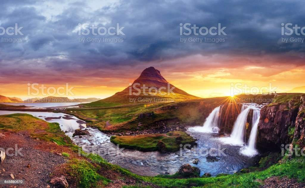 The picturesque sunset over landscapes and waterfalls. Kirkjufel stock photo