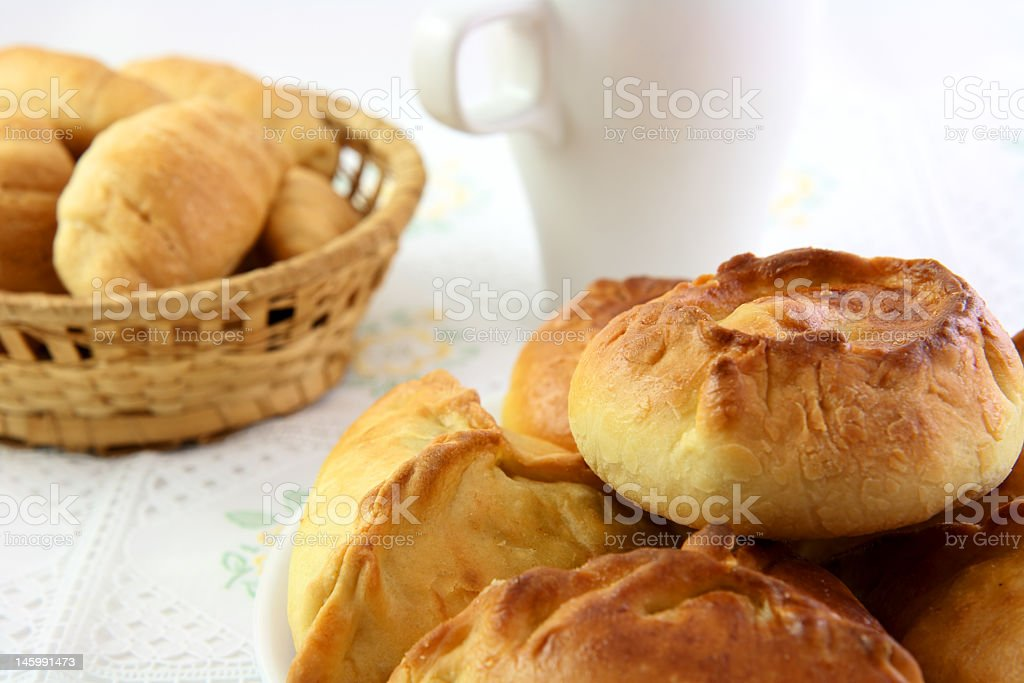 The pie with stuffing, croissant and white cup stock photo