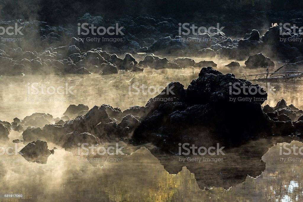 The pieces of lava in the morning mist stock photo