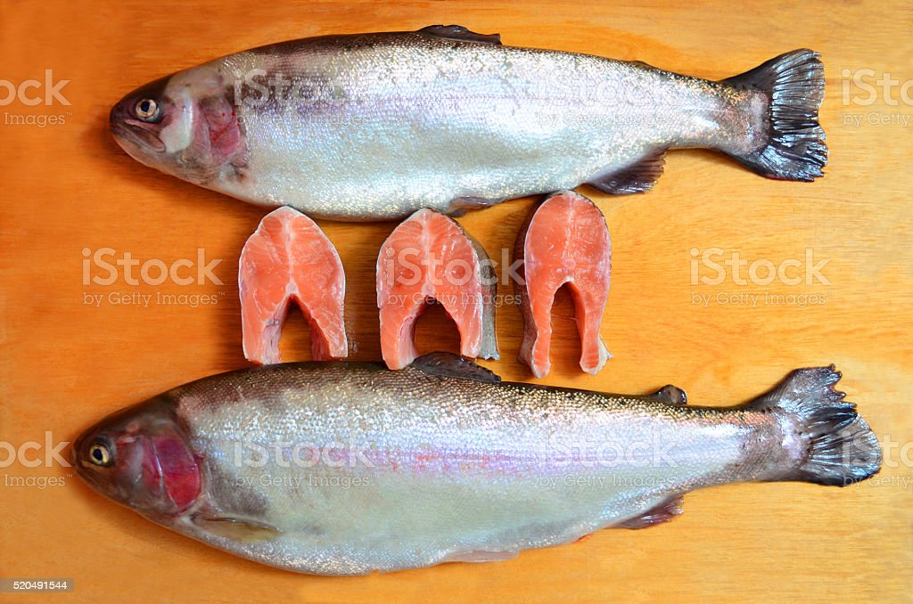 the pieces of trout on a wooden Board stock photo